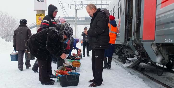 Purchasing food on the Trans-Sibeiran platform, Russia